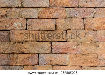 Old red brick, wall texture background, stained tiled brickwork horizontal pattern - stock photo