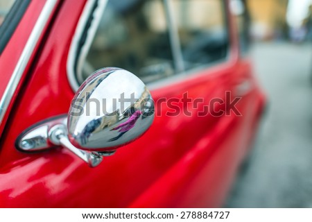 Old red car in Italy. - stock photo