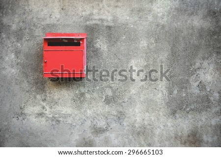 Old red mailbox. Vintage effect. - stock photo