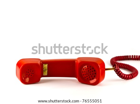 Old red  phone isolated on white background - stock photo