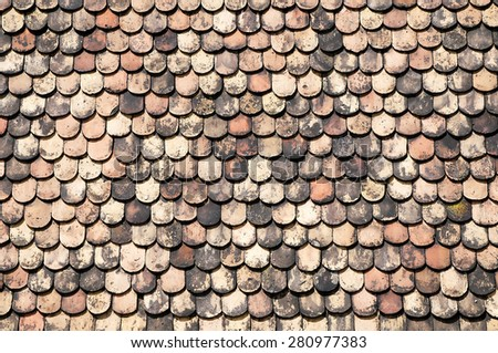 Old red roof tiles - stock photo