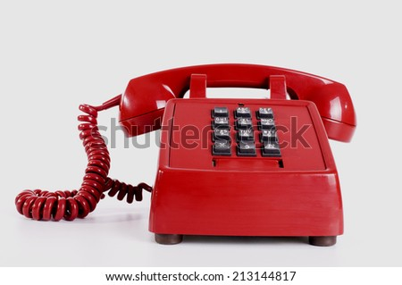 Old red telephone - stock photo