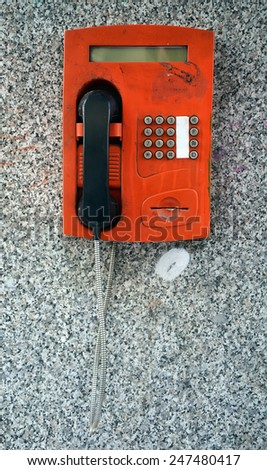Old red telephone booth - stock photo