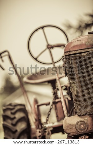 Old Red Vintage Tractor with no People - stock photo