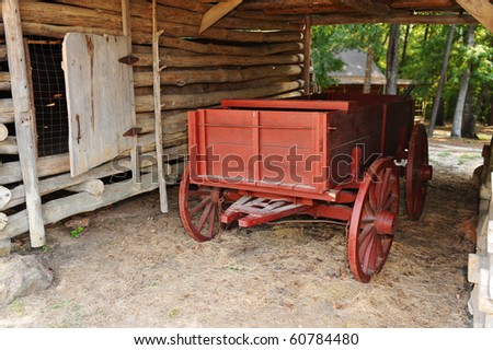 Old Red Western Wagon. - stock photo