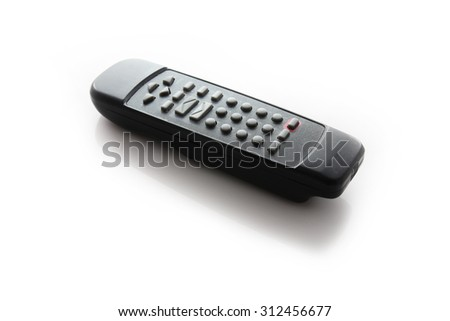 Old remote console for TV over white - stock photo