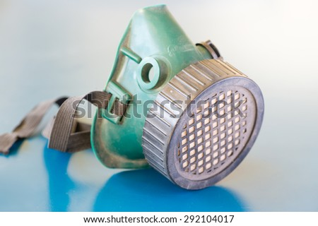 Old Respiratory Protection on blue background - stock photo