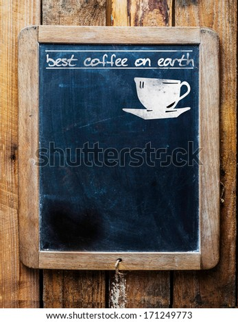 Old restaurant or coffee house menu on a rustic weathered old vintage school slate with a silhouette of a cup and the text - best coffee on earth and blank copyspace - stock photo