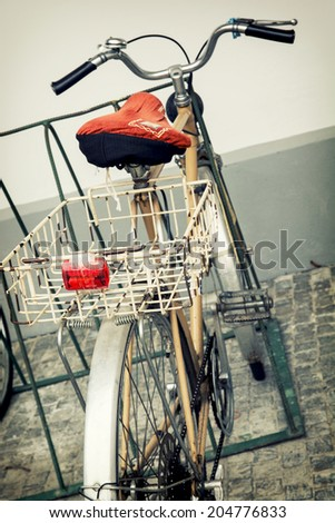 Old retro bicycle with empty metal basket. - stock photo
