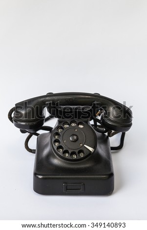 Old retro black phone, isolated in white background - stock photo