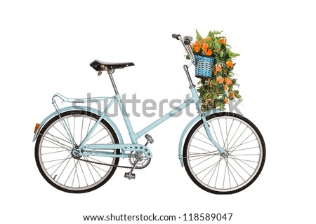 Old retro blue bicycle with flowers bouquet in basket isolated on white background - stock photo