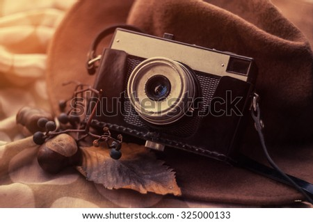 Old retro camera. Vintage still life. Vintage background - stock photo