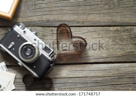 Old retro camera with heart love photography creative concept - stock photo
