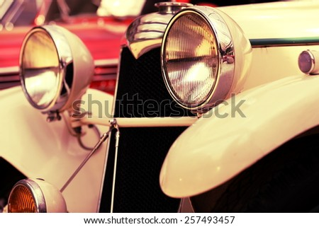 old retro car on the road street - stock photo