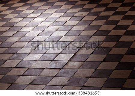 Old retro floor made of dark and bright squares. Soft focus, filters applied. - stock photo