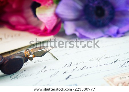 old retro golden quill pen and antique letters with flowers - stock photo