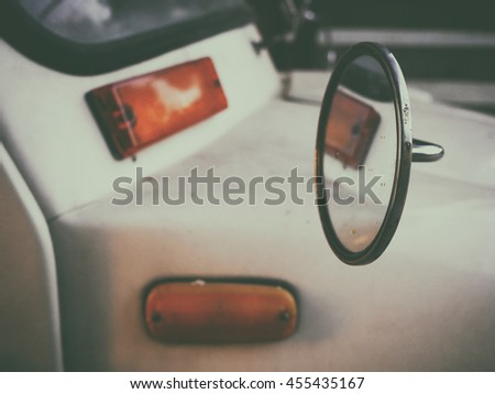Old retro or vintage car or automobile front side - stock photo