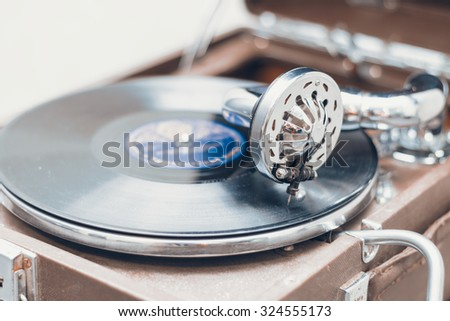 Old retro portable gramophone closeup, macro shot - stock photo