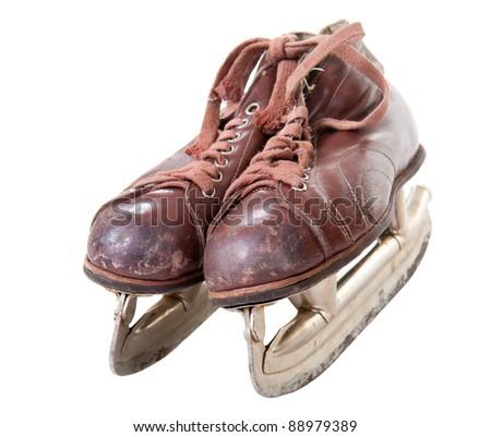 Old retro skates isolated over white background - stock photo