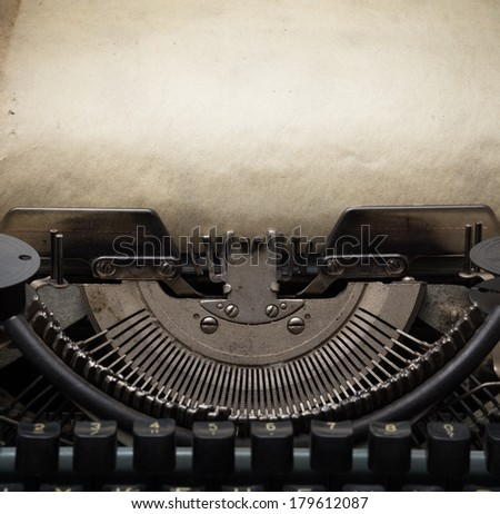 old retro typewriter with paper  - stock photo