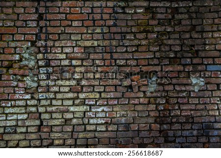 old retro vintage aged  abstract grunge texture abandoned red brick  wall fence with black white spot and crack background Empty space for inscription  - stock photo