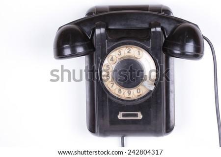 Old retro wall phone - stock photo