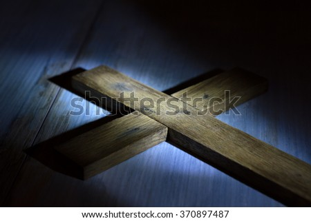 Old retro wooden cross in night abstract easter concept - stock photo