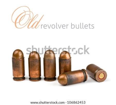 old revolver bullets on a white background - stock photo