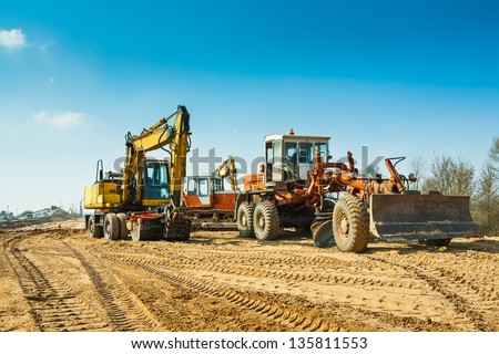 old roadworking mashines - stock photo