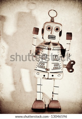 old robot  toy  (retro inspired image ) - stock photo