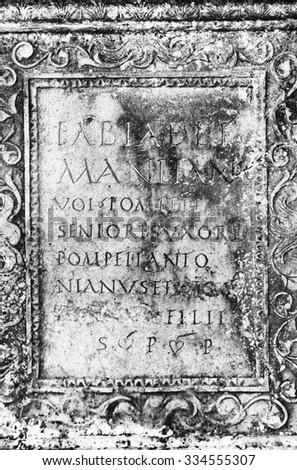 Old Roman stone inscription - stock photo