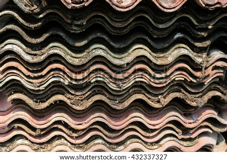 Old roof tiles background and texture. - stock photo