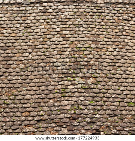 Old  roof tiling texture, damaged and ruined. - stock photo