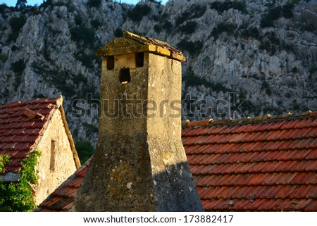 Old roof with chimney on abandoneh house - stock photo
