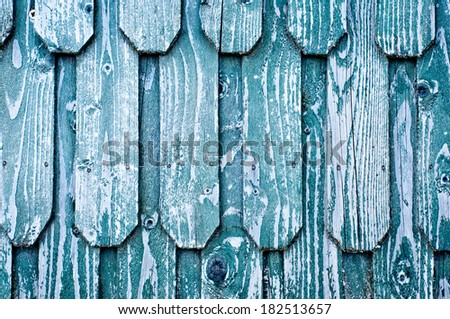 Old roof, wooden shingles. Texture of weathered blue wood. - stock photo