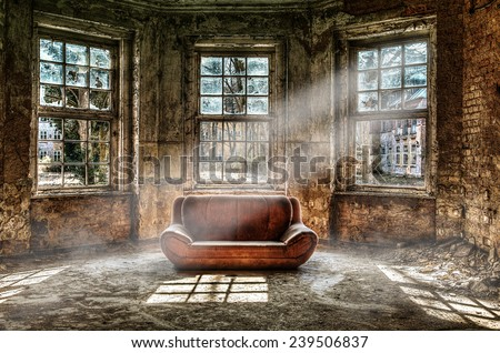 Old room with a couch - stock photo
