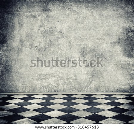 Old room with concrete wall and tiled floor - stock photo