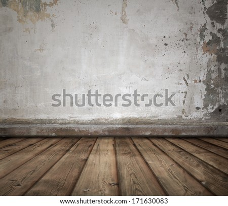 old room with concrete wall and wooden floor - stock photo