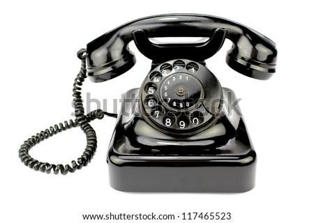Old rotary phone on white background. - stock photo