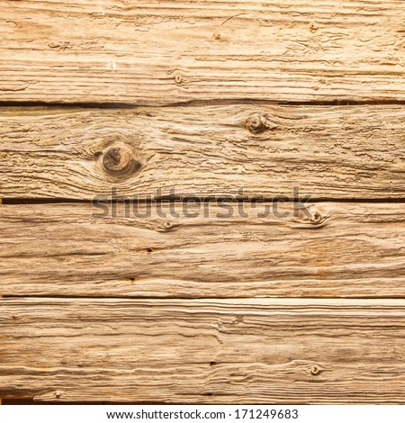 Old rough rustic wooden background texture with aged and weathered boards with a distressed surface and knots in closeup detail - stock photo