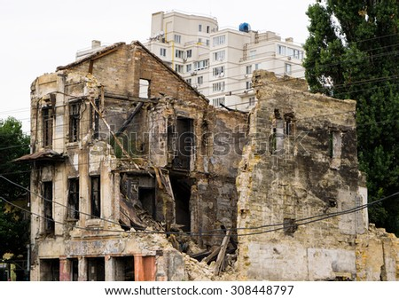 Old ruined house in city after bombing - stock photo