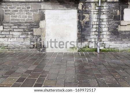 Old ruined wall with door - stock photo