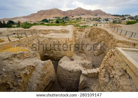 Old ruins and remains in Tell es-Sultan better known as Jericho the oldest city in the world, with the mount of temptation on the background. - stock photo