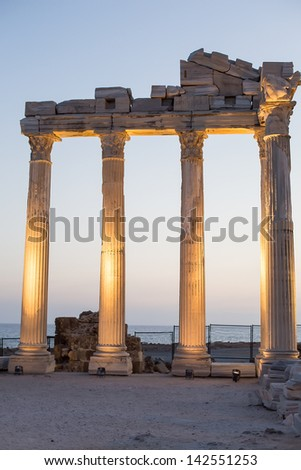 Old ruins in Side, Turkey at sunset evening - archeology background - stock photo