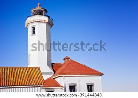 Old run down lighthouse along the ocean coastline in Washington State. - stock photo