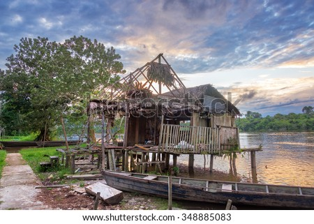 Old run down shack on the Javari River in the Amazon rain forest in Brazil - stock photo