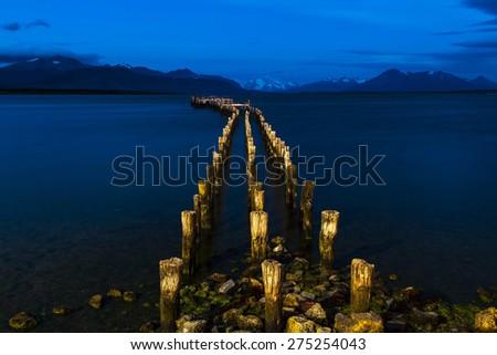 old runway in the harbor of Puerto Natales in Patagonia - stock photo
