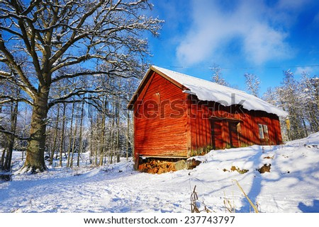 old rural barn, cottage, winter and snow scenery from Sweden - stock photo