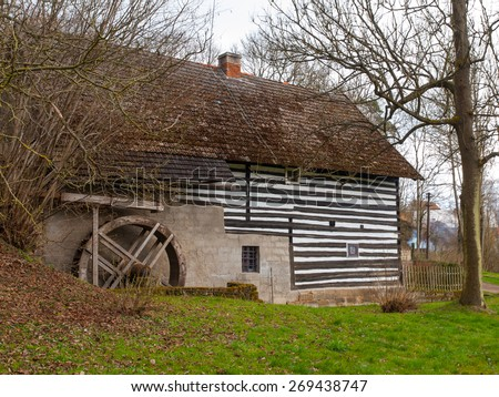 Old rural watermill with ancient water wheel - stock photo