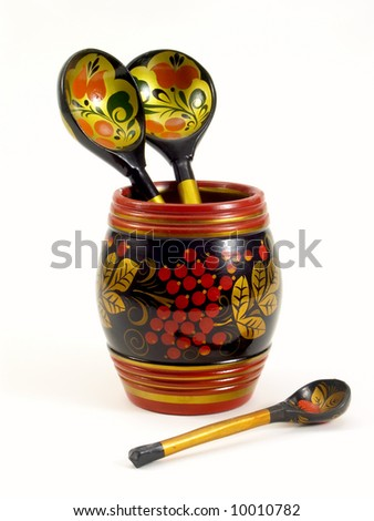 Old russian folk handpainted wooden kitchen ware isolated on white - stock photo